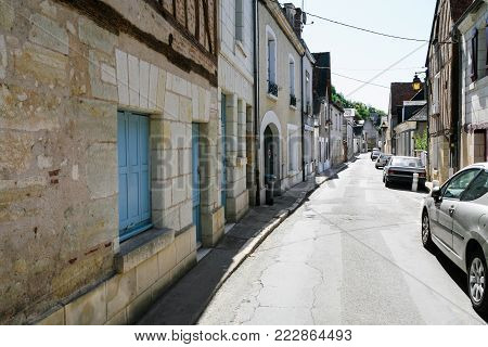 travel to France - residential houses and cars on narrow street Rue Victor Hugo in Amboise town in Val de Loire region in sunny summer day