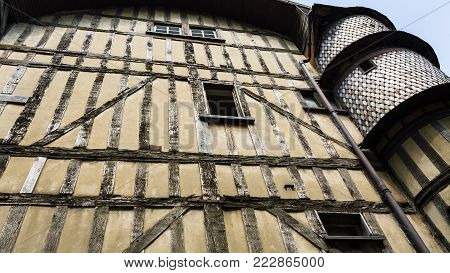 travel to France - old half-timbered house with tower on street Rue Champeaux in Troyes city