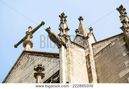 travel to France - cross and gargoyle of Basilique Saint-Urbain de Troyes (Basilica of Saint Urban of Troyes)