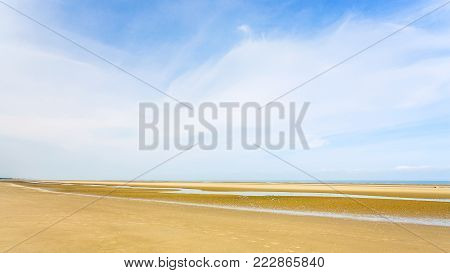 travel to France - panoramic view of blue sky over yellow sand beach of Le Touquet (Le Touquet-Paris-Plage) on coast of English Channel