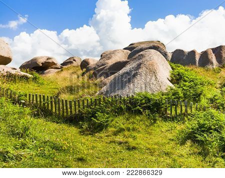 travel to France - granite rocks in natural park of Ploumanac'h site of Perros-Guirec commune on Pink Granite Coast of Cotes-d'Armor department of Brittany in sunny summer day