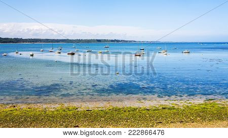 travel to France - marina in bay Anse de Perros of English Channel near Perros-Guirec commune on Pink Granite Coast of Cotes-d'Armor department in the north of Brittany in sunny summer day