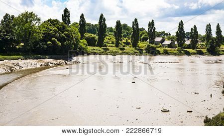 travel to France - muddy Jaudy river near la Roche-Derrien village in Cotes-d'Armor department of Brittany in sunny summer day