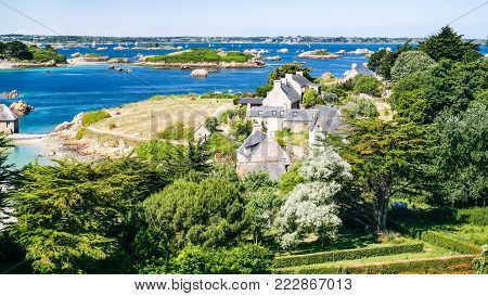 travel to France - above view of country houses on ocean coast in Brehat commune at Ile-de-Brehat island in Cotes-d'Armor department of Brittany in summer sunny day