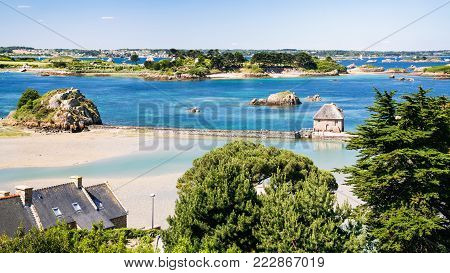 travel to France - above view of coast with tide mill Birlot in Brehat commune at Ile-de-Brehat island in Cotes-d'Armor department of Brittany in summer sunny day