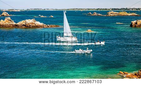 travel to France - view of ocean with yacht and boats near Ile-de-Brehat island in Cotes-d'Armor department of Brittany in summer sunny day