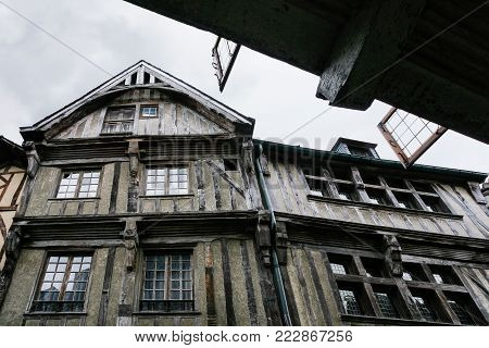 travel to France - facade of old half-timbered house in Dinan town in rain