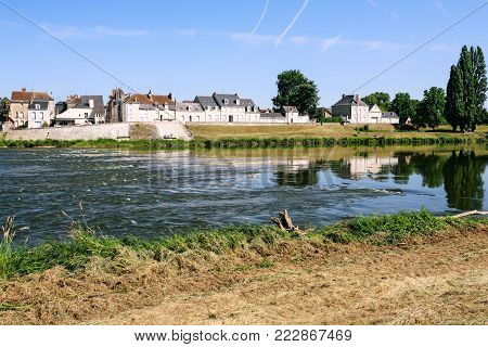 Travel to France - view of houses on Quai Francois Tissard on island Ile d'Or in Amboise town at riverbank of Loire river in Val de Loire region in sunny summer day