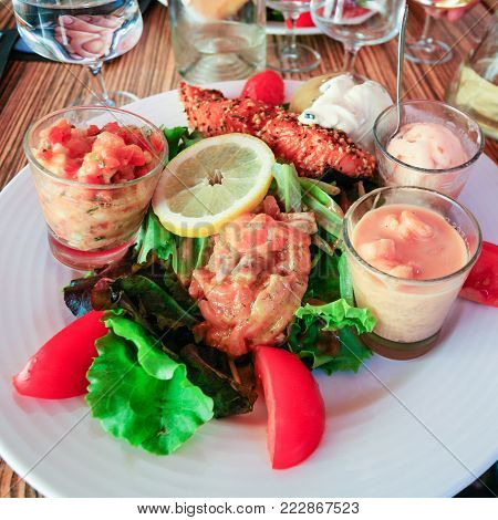 travel to France - big salad with fish on plate in outdoor cafe in Amboise town in Val de Loire region