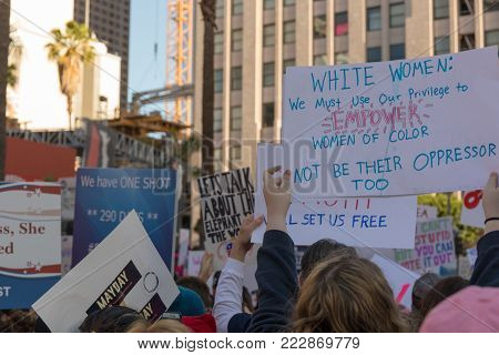 LOS ANGELES, CALIFORNIA - JANUARY 20, 2018:  2nd Annual Women's March marchers holding sign that reads,