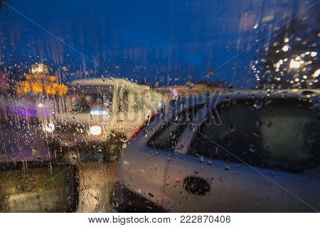 Rain drops on car glass. Rainy days, Night. Rain drops on window, rainy weather, rain background. Drops Of Rain On Glass Background