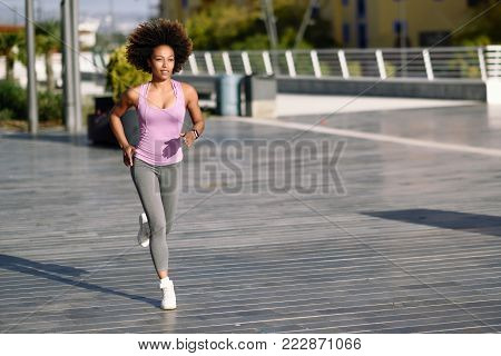 Black Woman, Afro Hairstyle, Running Outdoors At Sunset