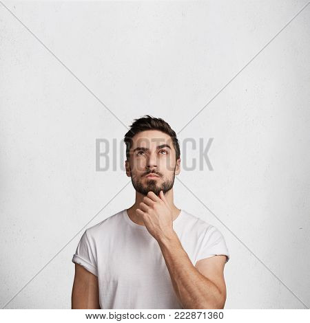 Confident Thoughtful Attractive Young Elegant Brunet Male Model With Clever Expression, Keeps Fore F