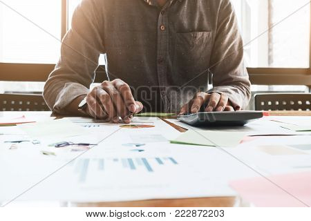Close Up Of Businessman Or Accountant Hand Holding Pen Working On Calculator To Calculate Business D