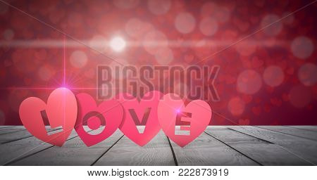 red paper hearts with text; love, on wooden floor and shiny background, valentines card (3d render)