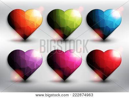 Abstract vector web buttons set of 6. Low poly hearts in 6 different colors. Heart icon. Isolated with realistic, transparent shine and shadow on the light background. Vector illustration. Eps10.