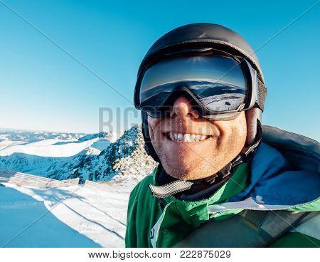 Skier man portrait in safe ski equipment