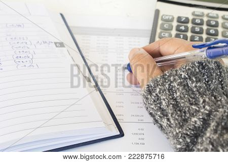report financial statement yearly balance sheet with hand of woman working at office desk