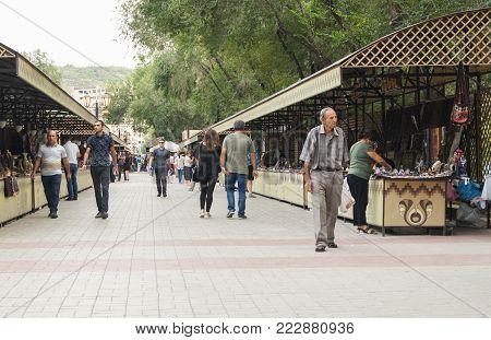 Yerevan, Armenia - 26 September, People between the trading rows, 26 September, 2017. Goods and people in the market of Yerevan.Yerevan.