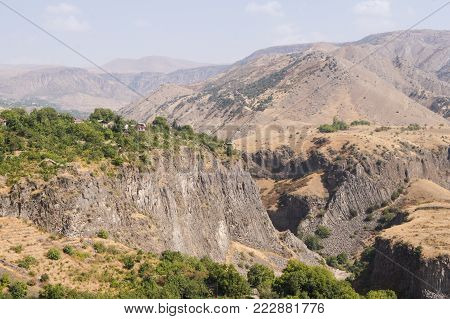 The precipitous mountain slope. Mountain landscapes of peaks and ridges of Armenia.