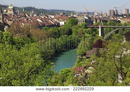 Cityscape of Bern, Switzerland with old historic houses and clock tower, view from above