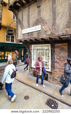 YORK, ENGLAND, - JULY 4, 2017: The Shambles, York`s famous historic streets which provided the inspiration for Diagon Alley in the Harry Potter series.