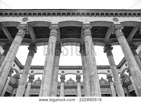 Historical building with column and bas-relief of the Soviet era in expocenter, Kiev, Ukraine. Black and white image