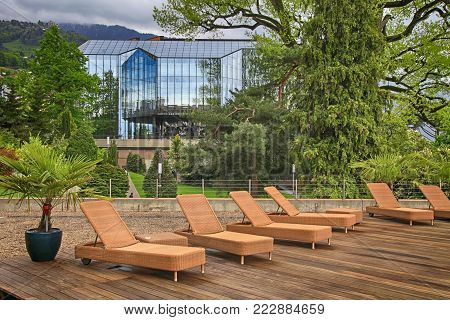 outdoor terrace with deck chairs in hotel, Montreux, Switzerland. Montreux is located on Lake Geneva at the foot of the Swiss Alps.