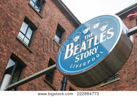 LIVERPOOL, ENGLAND - APRIL 20, 2012 : Sign  of The Beatles Story at Albert Dock, United Kingdom. The famous museum and exhibition about the music band The Beatles.