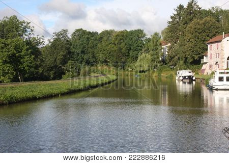 Pleasure boats on the Canal des Vosges in france