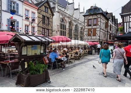 TROYES, FRANCE - JUNE 29, 2010: tourist walk to outdoor restaurants on square Place Alexandre Israel in Troyes city. Troyes is the capital of the Aube department in Champagne region of Northern France