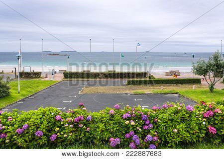 PERROS-GUIREC, FRANCE - JULY 2, 2010: car parking on Boulevard de Trestrignel near beach Plage de Trestrignel in Perros-Guirec town in the Cotes-d'Armor department in Brittany in rainy summer day