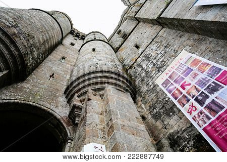 LE MONT SAINT-MICHEL - JULY 5, 2010: bottom view of castle walls of Saint Michael's Abbey. Le Mont Saint-Michel is an island commune in Normandy
