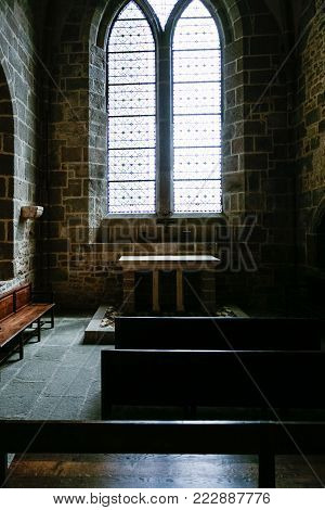 LE MONT SAINT-MICHEL - JULY 5, 2010: room in Saint Michael's Abbey. Le Mont Saint-Michel is an island commune in Normandy, first monastic on the mount was built in the 8th century
