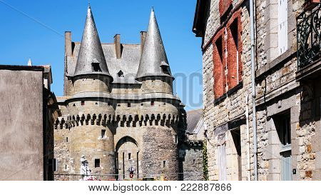 VITRE, FRANCE - JULY 7, 2010: view of Gatehouse of medieval castle Chateau de Vitre from street Rue du Chateau. The first stone castle was built by baron Robert I of Vitre at the end of the 11th cent