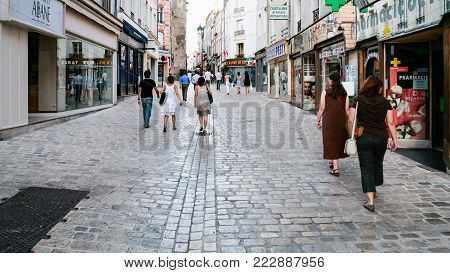ORLEANS, FRANCE - JULY 7, 2010: people walk on street Rue de Bourgogne in Orleans city in summer evening. Orleans is the capital of the Loiret department and Centre-Val de Loire region