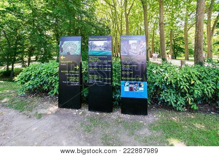 CHENONCEAUX, FRANCE - JULY 8, 2010: information boards in garden near castle Chateau de Chenonceau. The current palace was built in Indre-et-Loire departement of Loire Valley in 1514-1522