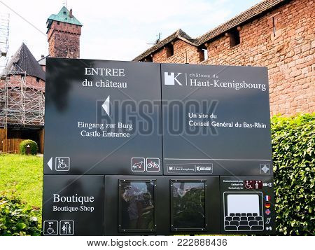 ORSCHWILLER, FRANCE - JULY 11, 2010: information board in castle Chateau du Haut-Koenigsbourg in Alsace. First time the castle was mentioned in 1147, the building was restored and rebuilt in 1900-1908