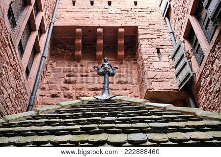 ORSCHWILLER, FRANCE - JULY 11, 2010: roof top at gate of castle Chateau du Haut-Koenigsbourg in Alsace. First time the castle was mentioned in 1147, the building was restored and rebuilt in 1900-1908