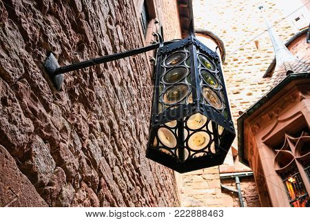 ORSCHWILLER, FRANCE - JULY 11, 2010: medieval lantern in castle Chateau du Haut-Koenigsbourg in Alsace. First time the castle was mentioned in 1147, the building was restored and rebuilt in 1900-1908