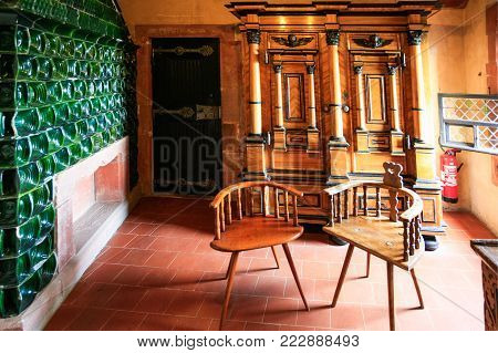 ORSCHWILLER, FRANCE - JULY 11, 2010: room interior of castle Chateau du Haut-Koenigsbourg in Alsace. First time the castle was mentioned in 1147, the building was restored and rebuilt in 1900-1908