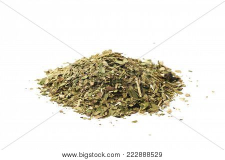 Pile of mate tea leaves isolated over the white background