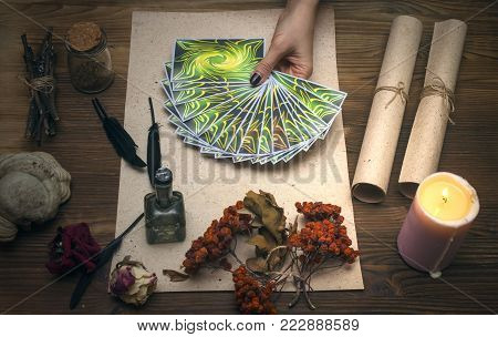 Tarot cards on fortune teller desk table. Witch doctor. Witchcraft. Magic herbal collection.