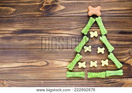 Christmas Tree Maden From Canine Chewing Bones And Cookies On Wooden Background