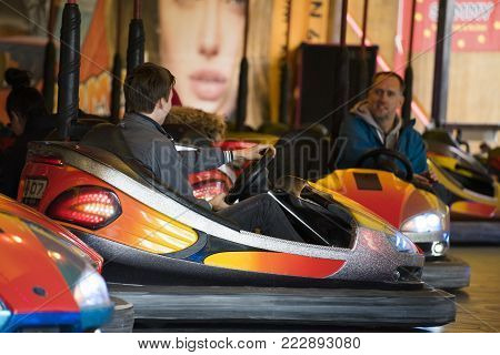 Leiden, The Netherlands 3 October 2017, A young boy and his father enjoying the bumper cars attraction fair