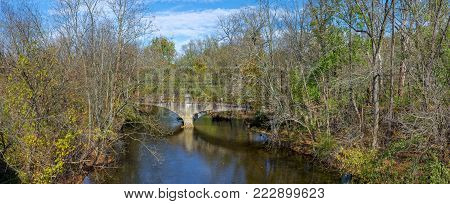 The abandoned 1913 reinforced concrete bridge spans the Musconetcong River in the village of historic Imlaydale NJ.