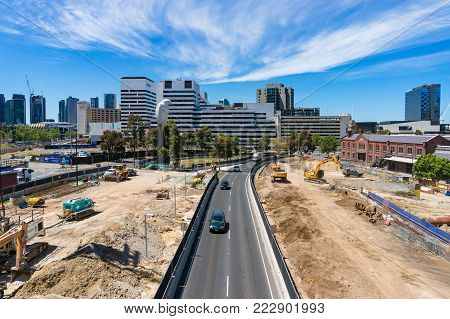 Melbourne, Australia - December 7, 2016: Wurunjery way with construction site and Melbourne cityscape on the background