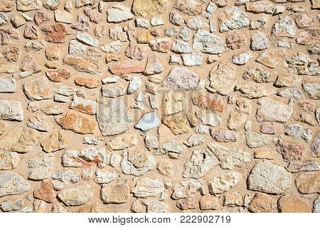 Background from a rough wall made of natural stone
