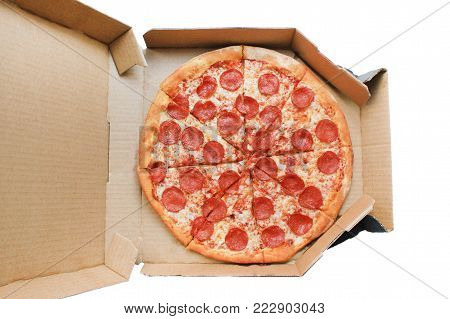 Pepperoni Pizza in Delivery Box Top View. Traditional Italian Pizza with Pepperoni Sausage, Mozzarella Cheese and Tomato Sauce. Original Recipe Pizza in Card Paper Box Isolated on White Background.