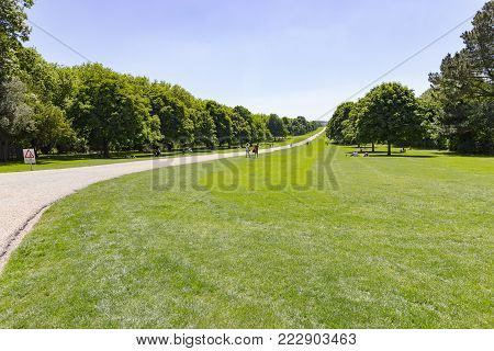 Windsor, England - 26 May 2017: View of the Park surrounding The Long Walk road in front of the Windsor Castle, hosting the royal family of England.